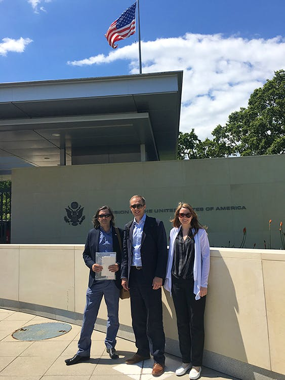 A photo of Dave, Chris & Mim outside the US Mission to the UN in Geneva.
