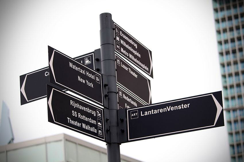 Headings signpost your content. Image shows a signpost.
